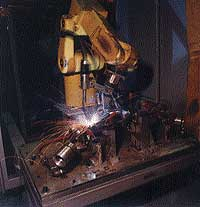 Cells have dual FANUC R-J2 ARC Mate 100i robots.