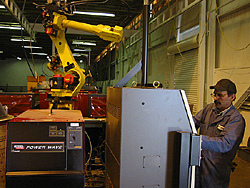 Robotic Arms Perform MIG Welds