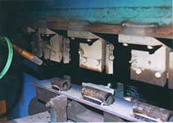 Closeup shows tube-to-plate weld setup.
