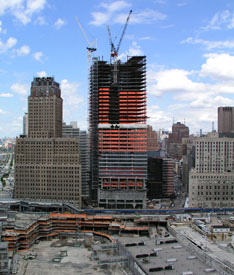A view from the front of the new Seven World Trade Center shows the nearly complete structural work and Manhattan setting.