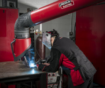 Man-welding-under-fume-arm